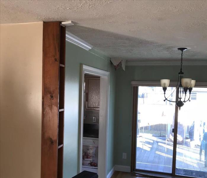 Storm Causes Hole & Water Damage Before